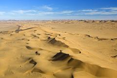 aerial shot, single-engine cessna flight over the sand dunes of the namib des - stock photo