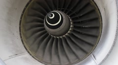 Commercial jet engine turbine closeup with spiral turning slowly Stock Footage