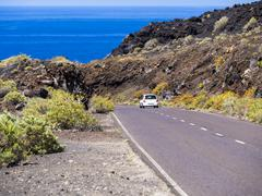 Spain, Canary Islands, La Palma, Faro de Fuencaliente, Country road and car Stock Photos