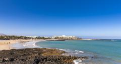 Spain, Canary Islands, Lanzarote, beach at Costa Teguise Stock Photos