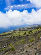 Spain, Canary Islands, La Palma, Puerto Naos, Coast and clouds Stock Photos