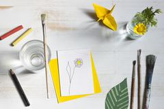 Still life with paintbrush, flower and bricolage Stock Photos