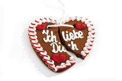 broken gingerbread heart, ich liebe dich - stock photo