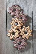 Six decorated Christmas cookies on grey wood Stock Photos