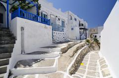 alley with painted paving stones in naoussa, paros, cyclades, greece, europe - stock photo