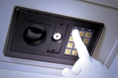 Stock Photo of safe with a hand