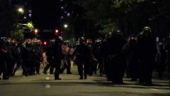 Group of riot officers marching military step while hitting batons Stock Footage