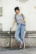 Portrait of young female skate boarder - stock photo