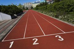 Stock Photo of cinder track on a sports field, potsdamer platz square, berlin mitte, central