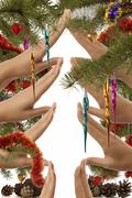 Conceptual christmas tree symbol made from hands Stock Photos