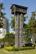carved wooden pillar in front of the museum in kuching, sarawak, borneo, mala - stock photo