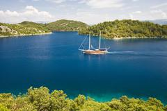 archipelago with a ssiling ship in the mljet national park, mljet island, dub - stock photo