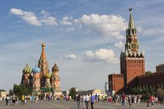 Russia, Moscow, Saint Basil's Cathedral with Kremlin Wall and Spasskaya Tower - stock photo