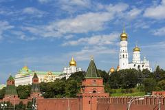 Russia, Moscow, Kremlin wall with towers and cathedrals - stock photo