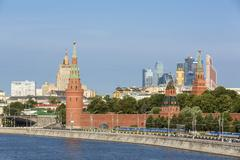 Russia, Moscow, River Moskva, Kremlin wall with towers and modern architecture - stock photo