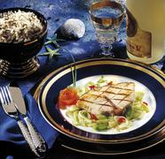 grilled halibut steak with leeks and rice - stock photo