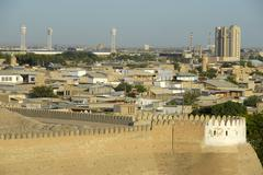 Modern city of buchara viewed over the crenels or battlements of the ark fort Stock Photos