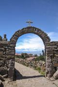 Stock Photo of South America, Peru, Tacquile Island, Arch with cross and path