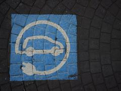 Spain, pavement with pictogram for parking lot of electric cars Stock Photos