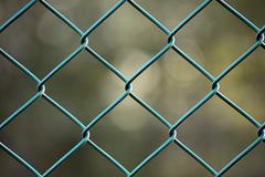 chain-link fence, green - stock photo