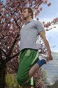 33 year-old man jogging in the city in spring Stock Photos