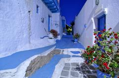 Blue and white painted alleyway in plaka, milos, cyclades, greece, europe Stock Photos