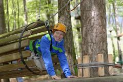 Austria, Alto Adige, Adventure Park Kaltern, Boy on high ropes course Stock Photos