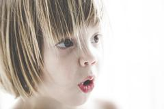 Portrait of astonished little girl Stock Photos