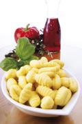 gnocchi with basil, italian ambience - stock photo