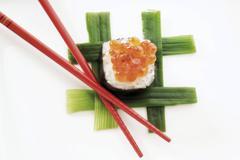 sushi chu maki made of salmon trout caviar and rice wrapped in nori seaweed,  - stock photo