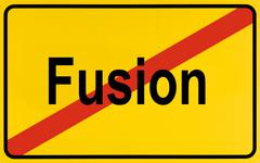 Sign, end of city limits, as symbol for ending mergers or fusion Stock Photos
