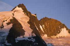 Stock Photo of peak of mt. grossglockner seen from the carnithian side with ascent tracks in