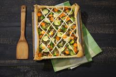 Stock Photo of Puff pastry tart with mincemeat, broccoli, carrot and zucchini