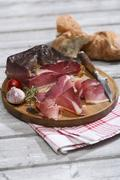 Speck Alto Adige with Italian white bread - stock photo