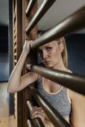 Serious woman at wallbars in gym Stock Photos