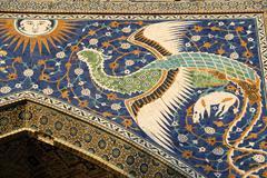 Artistic detail, majolica ceramics, peacock flying toward the sun, entrance t Stock Photos