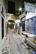 old market with display cases in a narrow alley, naxos city, cyclades, greece - stock photo