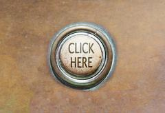 Old button - click here Stock Photos