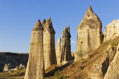 Turkey, Cappadocia, Ask Vadisi, Phalloid fairy chimneys at Goereme National Park - stock photo