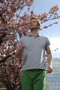 31-year-old man jogging in the springtime Stock Photos