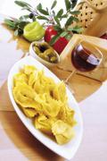 tortellini, italian ambience - stock photo