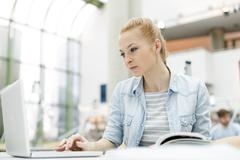 Student learning in a university library - stock photo