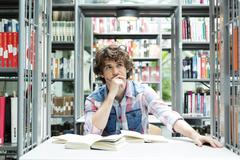 Stock Photo of Student in a university library reading
