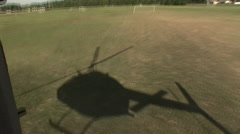 Shadow of helicopter taking off from the air Stock Footage