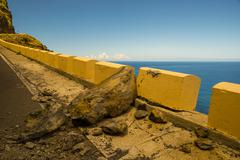 Spain, Canary Islands, Tenerife, rockfall, road at coast Stock Photos