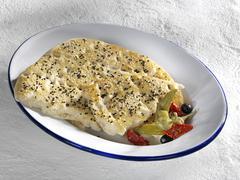 greek pita on an enamel plate - stock photo