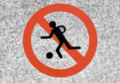 sign on a wall, playing football not allowed - stock photo