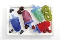 Stock Photo of homemade popsicle, ice lolly or ice pop mould, fresh fruit