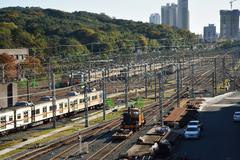 Junat, rautatiet ja kiskokulkuneuvon base Kuvituskuvat