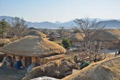 thatched roof house in korean traditional old town called nakan in korea - stock photo
